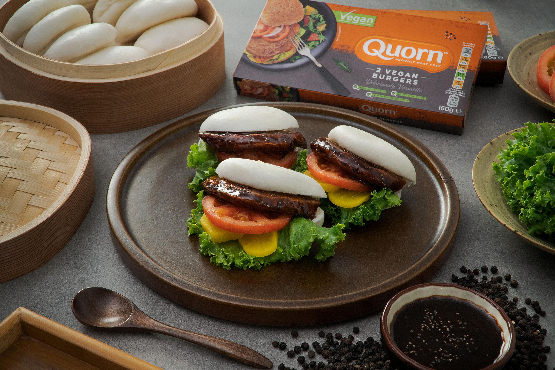 Pan Seared Vegan Burger with Black Pepper Sauce in Steamed Bun