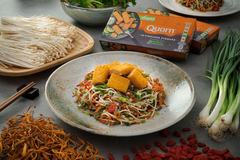 Crispy Vegan Fishless Fingers topped on Enoki Mushrooms and Cordyceps Flower Salad